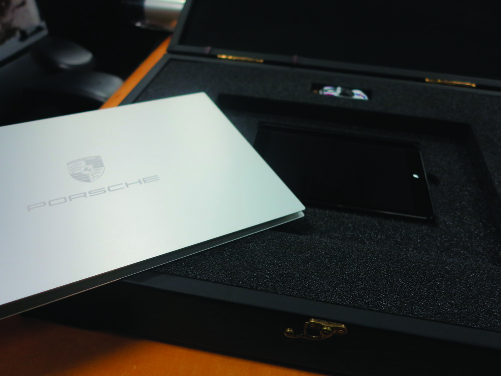 The booklet was bound in a custom-engraved metal cover—giving it a sleek, refined feel. All of the presentation components were housed inside the box.