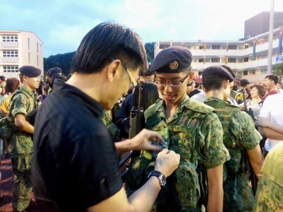 putting on the chevrons for this newly minted 3SG =)