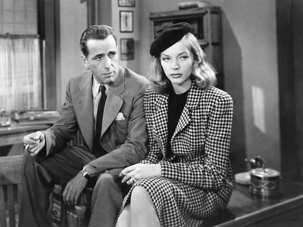 big-sleep-the-1946-002-humphrey-bogart-lauren-bacall-sitting-desk-00m-d93.jpg