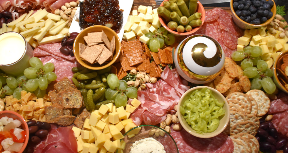 WHEN IN DOUBT, ADD CHEESE - No one is ever upset with a charcuterie board. The important part is adding extras for a full + balanced board. Try pickles, grapes, nuts, + olives.