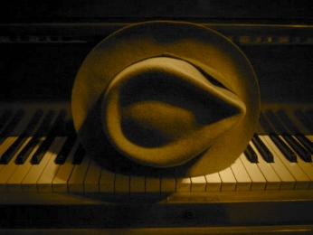 Mojo hat on piano sepia.jpg