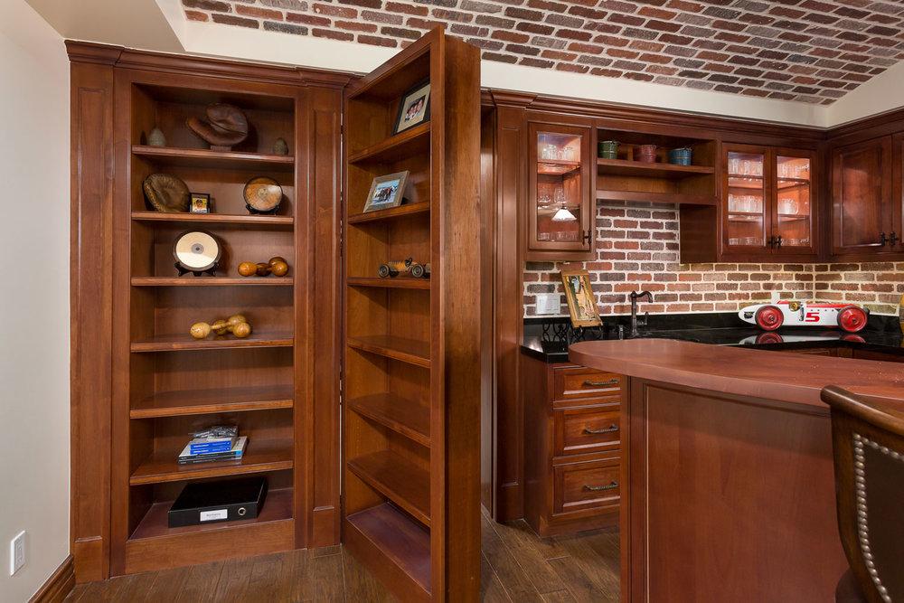 Chelsea-hidden-passage-bookcase-bar-basement.jpg