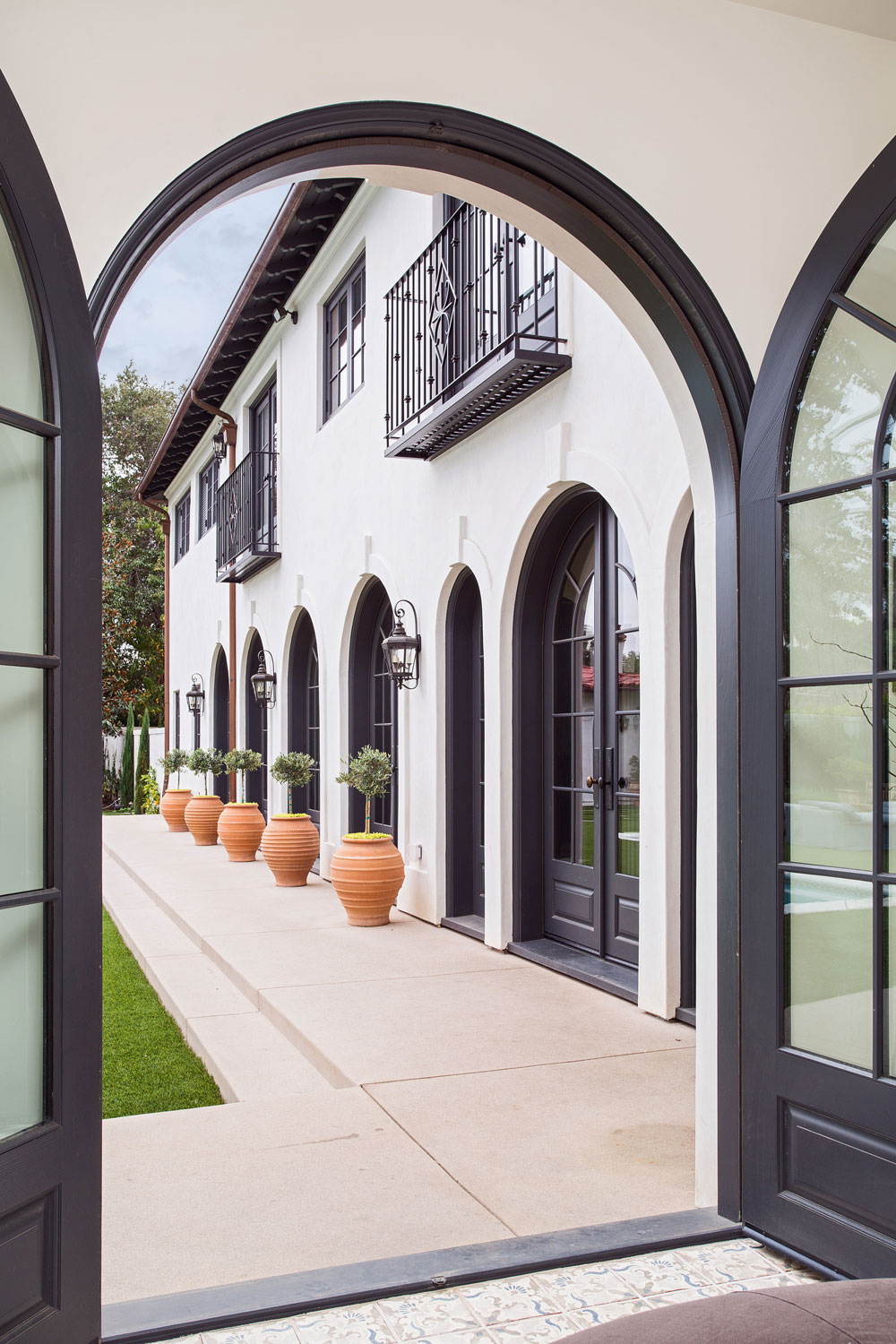 arched-steel-doorway-rear-yard-view-spanish-style-chelsea-construction.jpg