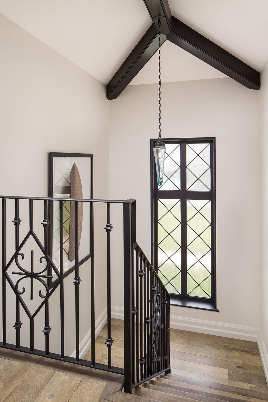 spanish-style-home-staircase-landing-minimal-ironwork-chelsea-construction.jpg