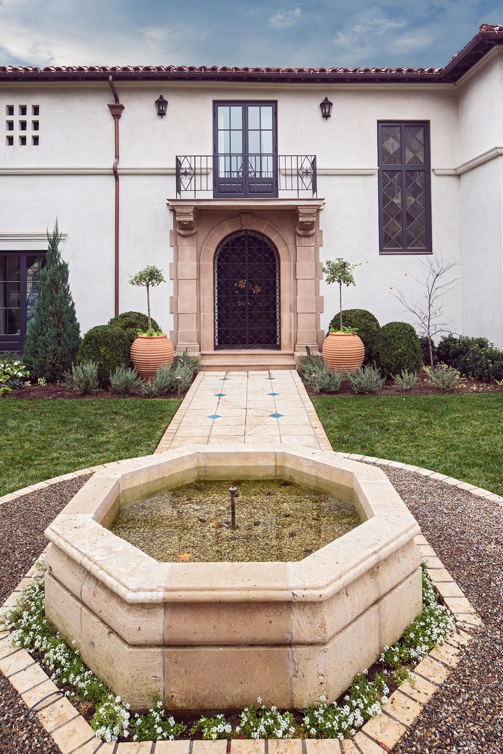 spanish-style-front-door-fountain-chelsea-construction.jpg