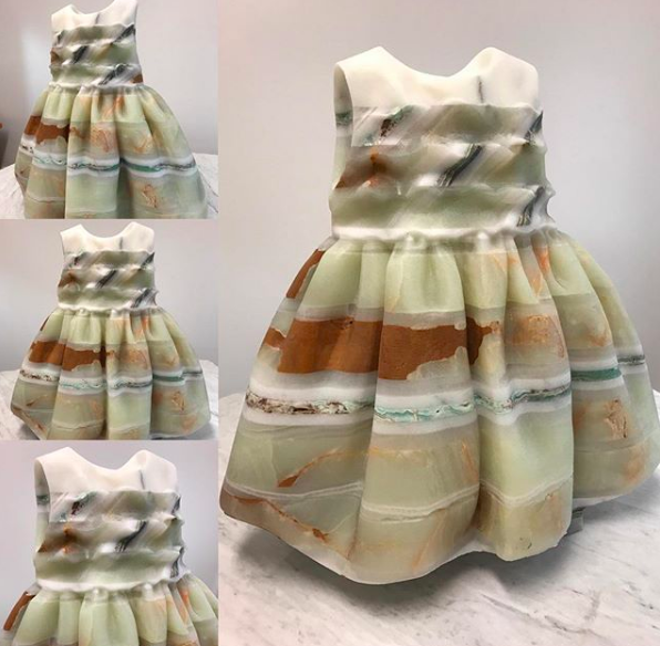 Child's dress which also references the artists interest in renaissance architecture