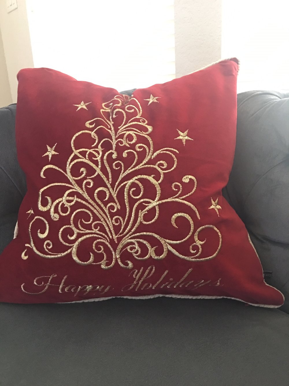 "- ""Happy Holidays"" pillow covers"