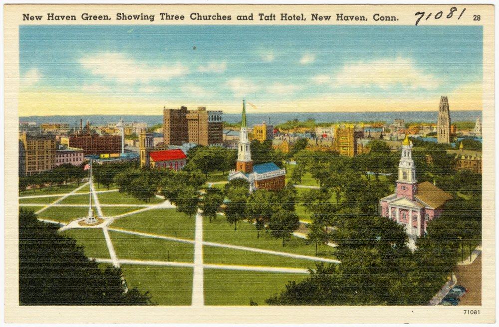 The New Haven Green circa 1935.  Facing southwest, with Yale  '  s Old Campus, and Harkness Tower, on the right.  Credit: Boston Public Library.