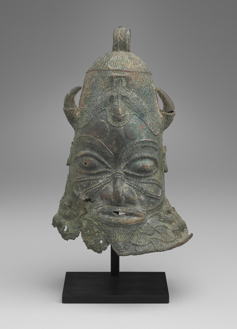 Bell in the Form of a Human Head,  13th–15th century, copper alloy (20 x 13 x 8 cm), Yale University Art Gallery, Charles B. Benenson, B.A. 1933, Collection.