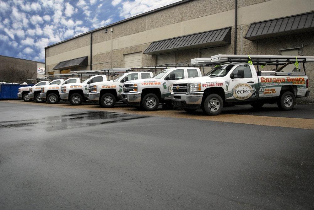 Precision Garage Door fleet lining up before their morning drive.
