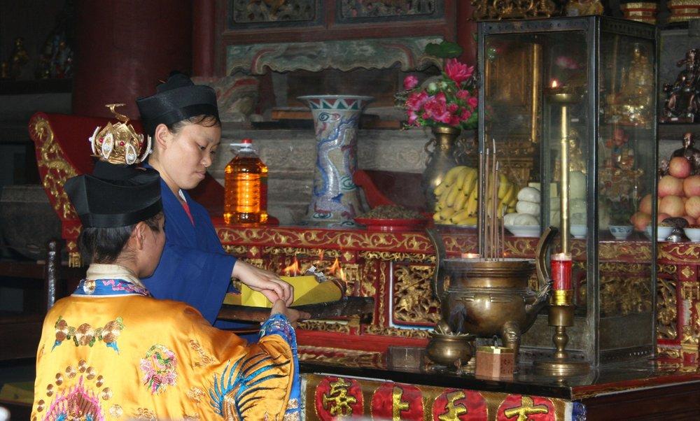 Daoist priestess burning talismans, Wudang Mountains, June 2009