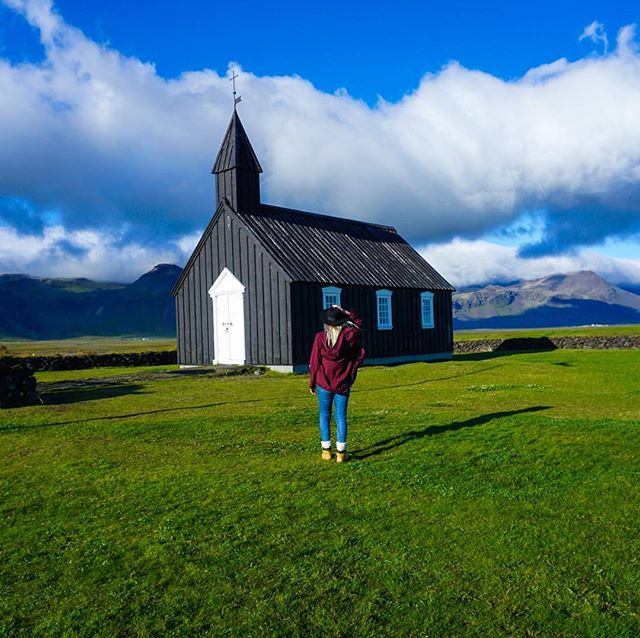 C H A R M 🖤 this small black wooden church is such a charmer, it is originally built in 1848 and then rebuilt in 1987. It is located in the west region of Iceland. It's name is Búðakirkja. I love it 🖤 tourists love it. . .  Photo @oskartryggva Sony a6000 . . . . . . . .  #iceland #ig_iceland  #everydayiceland #TLPicks #earthoutdoors #girlsthatwander #cabinfolk #girlslovetravel #gltlove #eclectic_shotz #girlboss #borderlessgirls #igersofficial #teamSELF #damestravel #nature #photography #DameTraveler, #TravelingLadies, #TheTravelWomen, #WomenWhoExplore, #WomenWhoHike, #WomenWhoTravel #Travelers #Exploring #Explorer #Wanderer #Wanderlust #travelbug