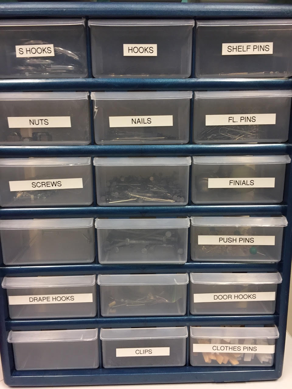 Even hardware has a place! Get a storage unit like this and label all the drawers.