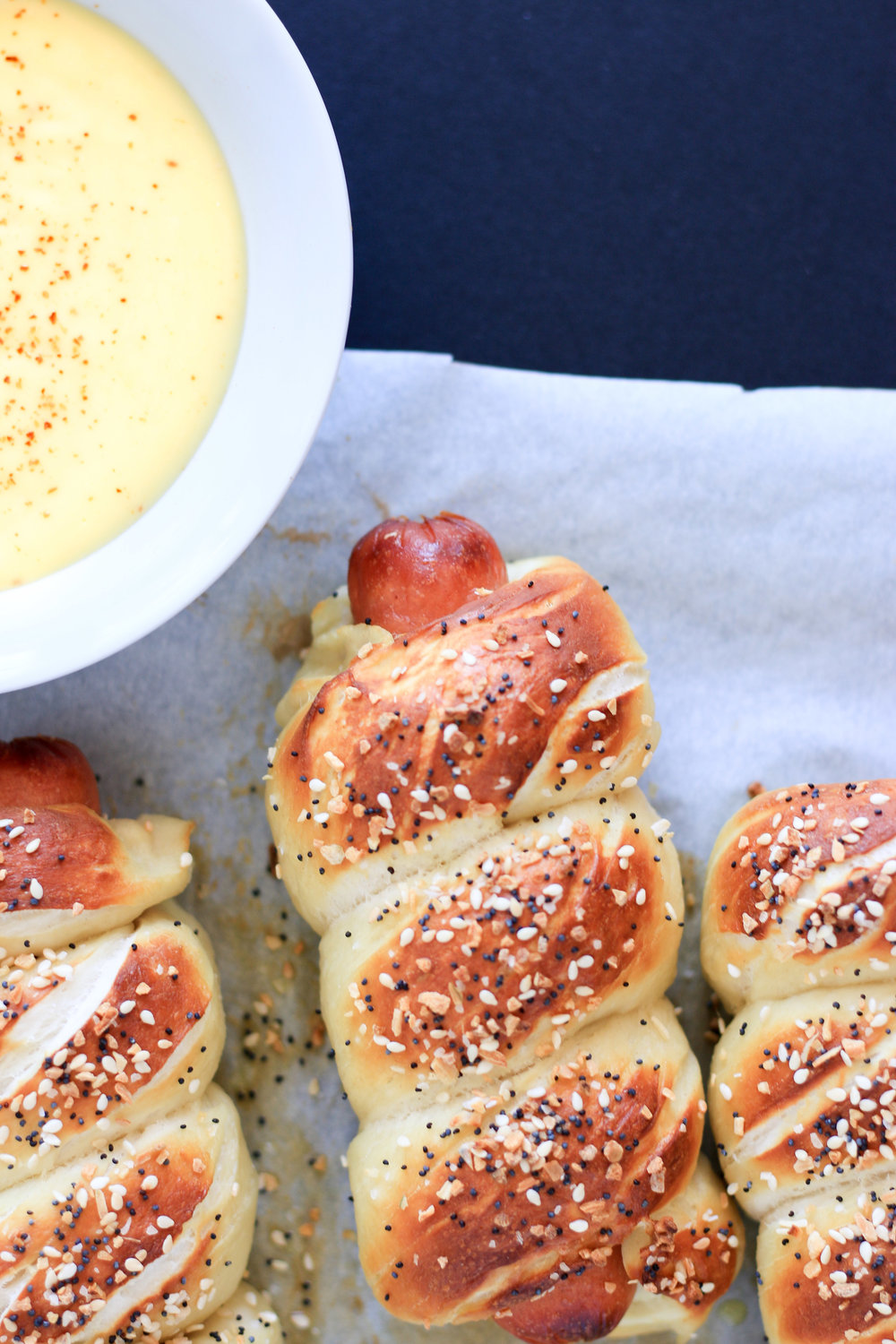 Pretzel Wrapped Hot Dogs with Everything Bagel Spice and Cheesy Mustard Dipping Sauce