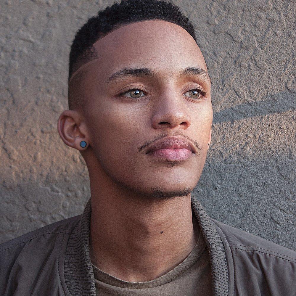 black adolescent male hust-wilson-590468-unsplash.jpg