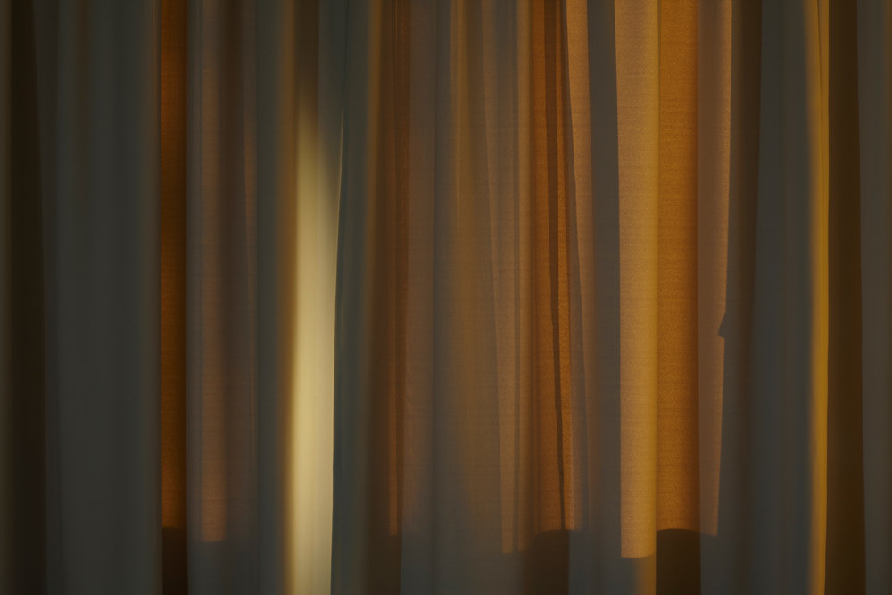 sun setting on grey curtains.jpg