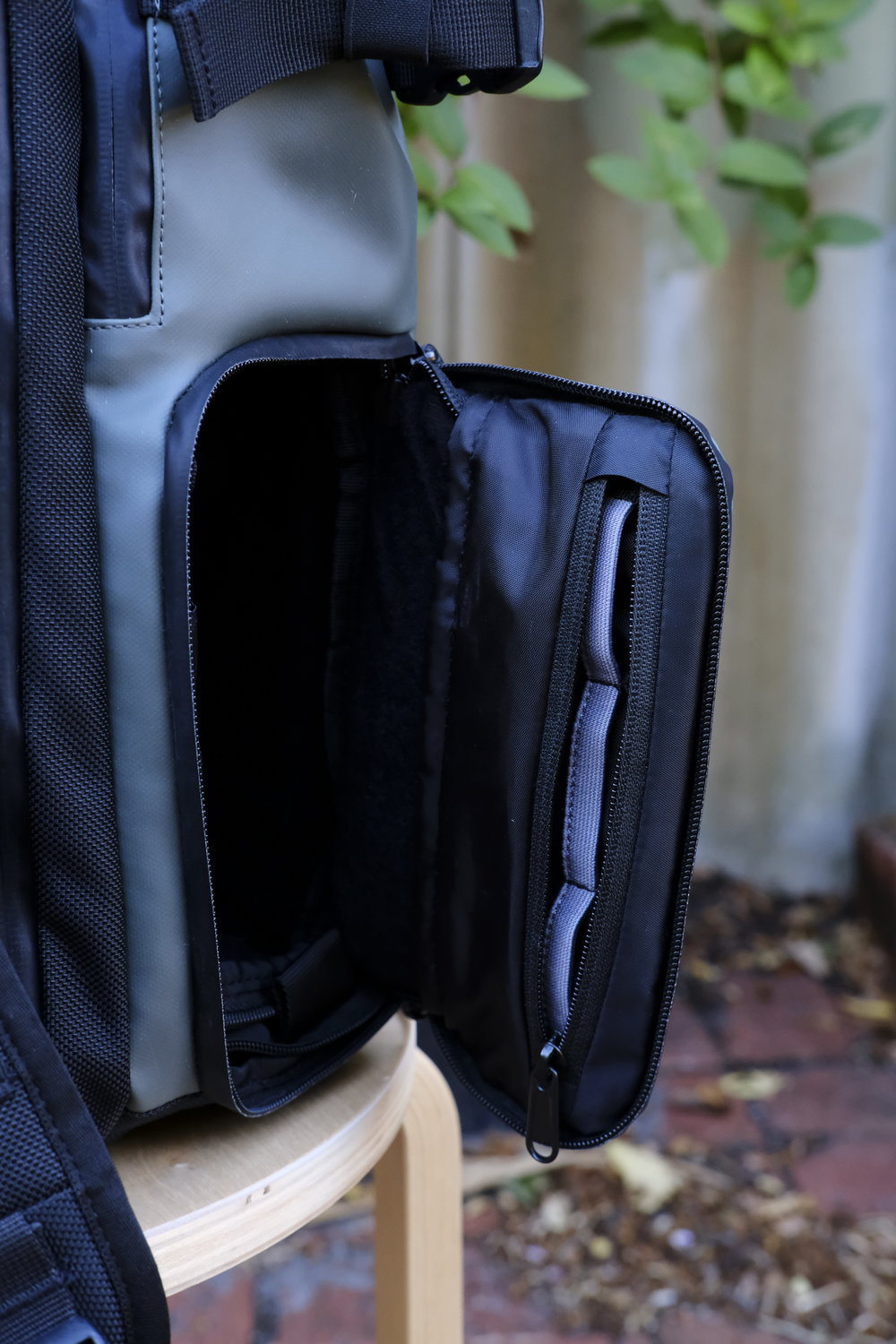 The zip compartment on the side pocket with space for 3 batteries.