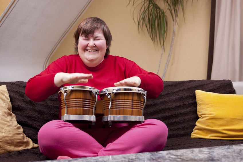 How can music therapy help adults with differing abilities? -