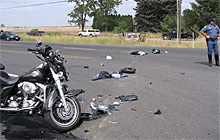 At the collision site, the Van Lears' motorcycle and the Jeep in the background.