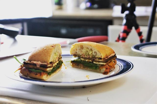 How about a Reuben for lunch??? Kyle used marinated tofu, dill and garlic sauerkraut, baby spinach, tomatoes, vegan cheese, and a house-made vegan thousand island dressing. #vegan #vegetarian #lunch #dinner #yum #yummy #food #diy #cooking #podcast #vlog #tofu #daiya #kraut #ciabatta #pickle #like #follow #subscribe #sub #november #holidays