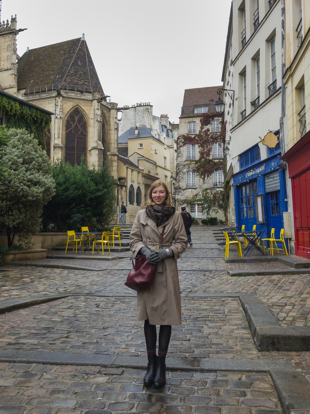The trench was necessary for a rainy day in the Marais.