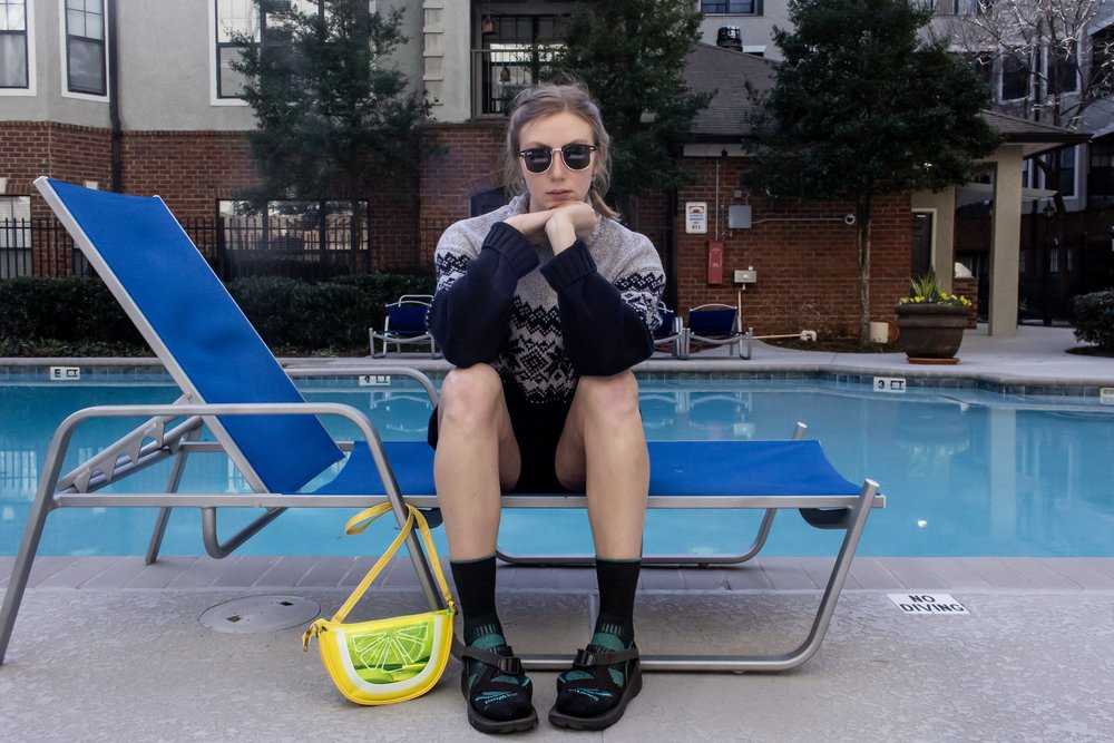 Sweater: vintage, bike shorts: Under Armour, socks: Smart Wool, sandals: Chacos, sunnies: Ray Ban, bag: Cracker Barrel