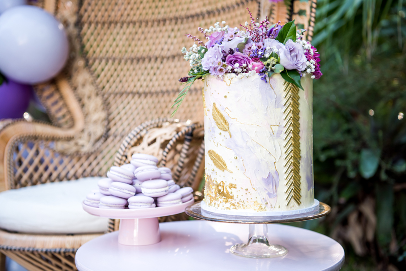 "Luxe Backyard Boho Picnic - OH IT'S PERFECT'Surrounding this sumptuous setting were a spread of gorgeous Morrocan wedding blankets and scattered, luxe handmade velvet fringed, and prana cushions. Mouthwatering macaroons, cake to die for, and sweet ""Love"" cookies were used to create a feast for the eyes.'"