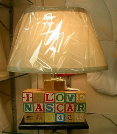 "Children's Alphabet Block Lamp    Remember your children playing with these wooden alphabet blocks?  This is a great lamp ideal for a child's room!  Standing 16"" high this lamp is very colorful.    This lamp features ""I Love Nascar"" and ""I'm a Reds Fan"" on the backside.  Other personalization could be available.    $155.00, plus shipping"