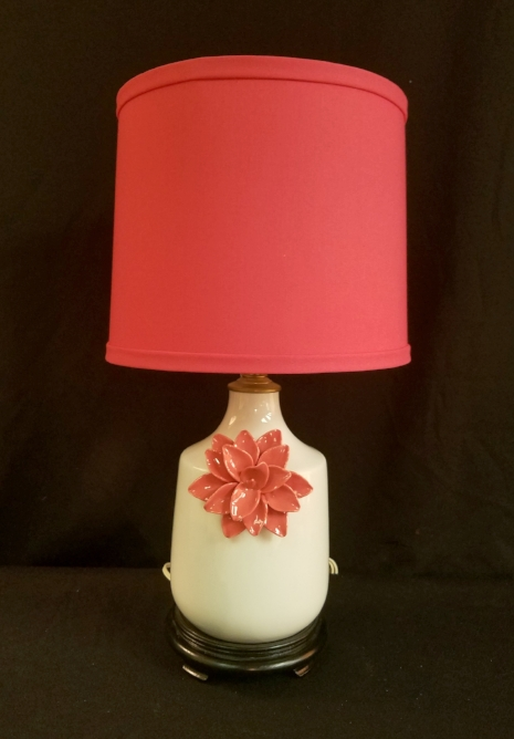 "Raised Pink Flower Lamp    This lamp is made from a vase with an attached raised porcelain floral. It stands 18.5"" tall to the top of the custom fabric lampshade.    $150.00, plus shipping"
