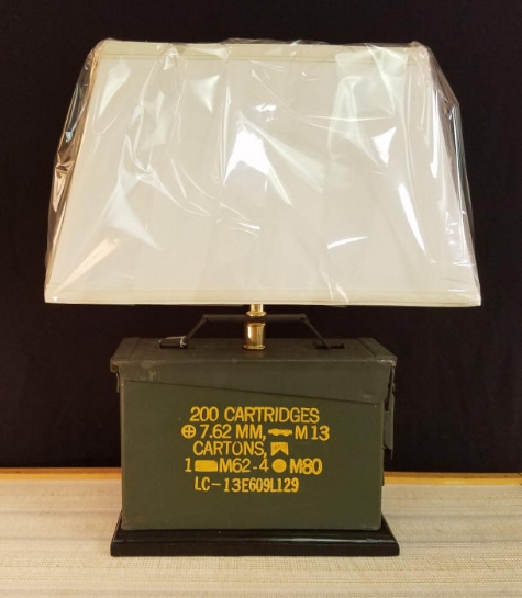 "Military Ammunition Box Lamp Ammo Lamp    Great for any Weapon Enthusiast or Military Person.    Designed from a Military Ammunition box, this lamp stands 19"" tall, including the Rectangular shaped lampshade.    This Ammo Box lamp is designed so you can open the box without taking the lamp apart, great for hiding your stash...      This box held, 200 Cartridges, 7.62 MM, M13 Cartons    $175.00, plus shipping"