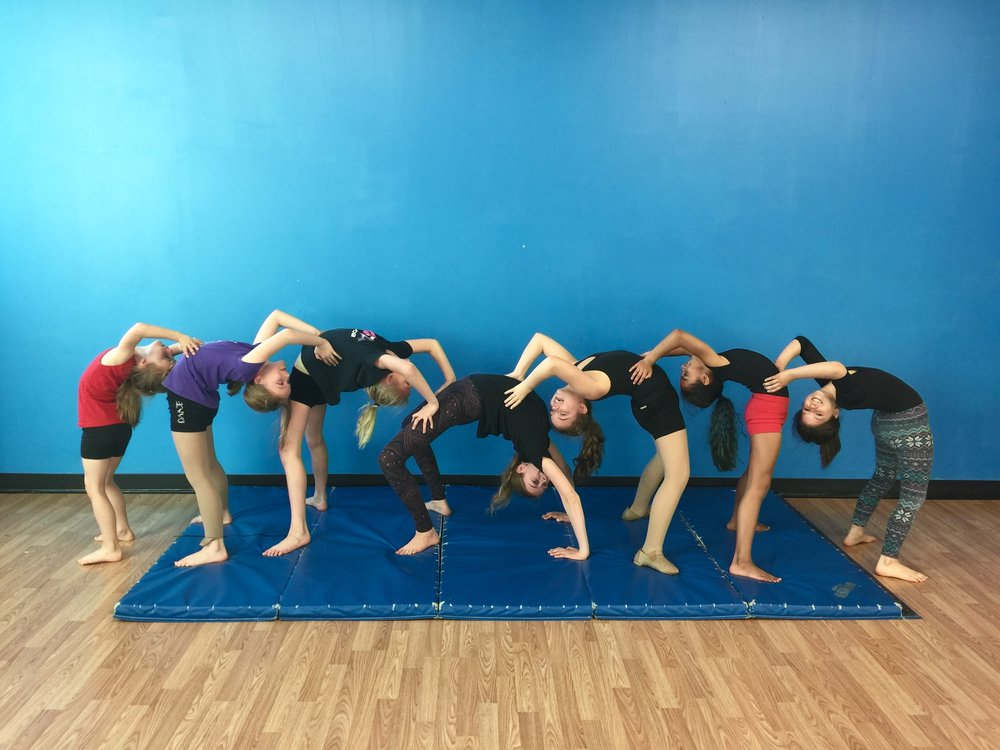 Dancers Gymnastics camp at MFA Studios. Learn acro tricks, tumbling, and work on your strength and flexibility in this camp.