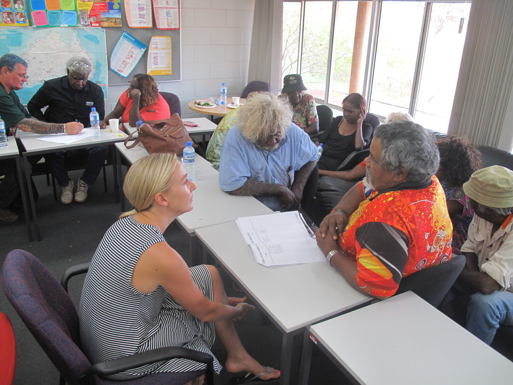 [PHOTO: ICV Volunteer Kayla (left) talking with Pilbara community members]