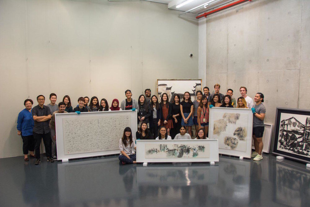 Exhibition team and students of SMU-X Arts and Cultural Management course on Exhibitions and Curating viewing artworks at Fine Art Storage Services, Singapore.