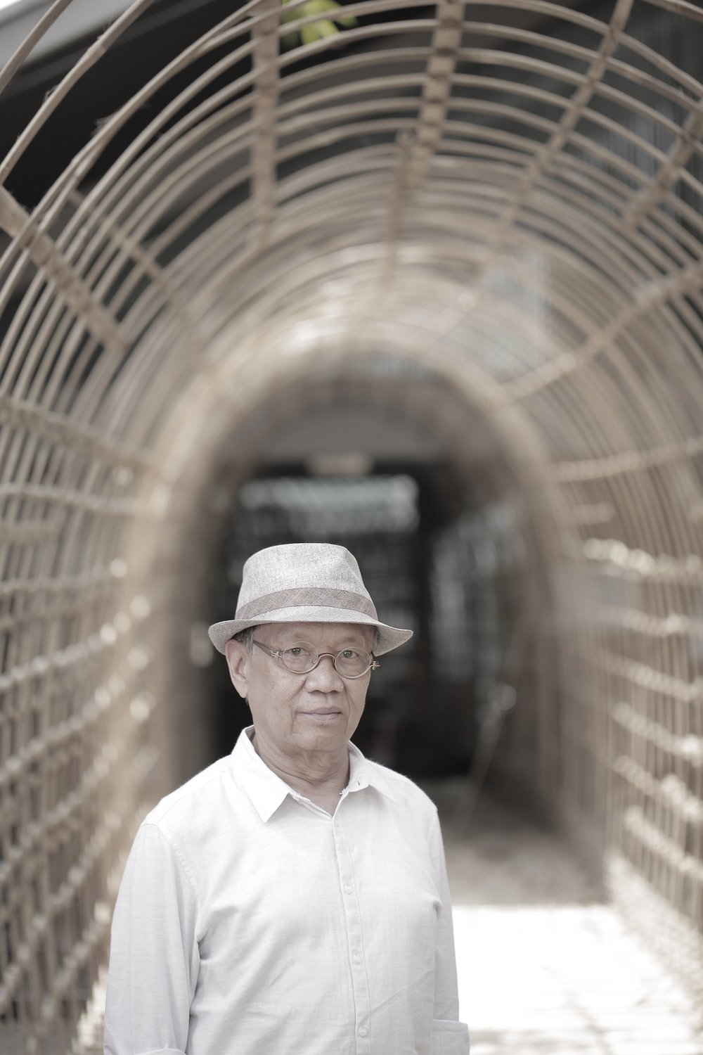 Sunaryo in front of title piece 'Lawangkala', 2018, bamboo and rattan, site-specific installation, dimensions variable. Image courtesy of Selasar Sunaryo Art Space.