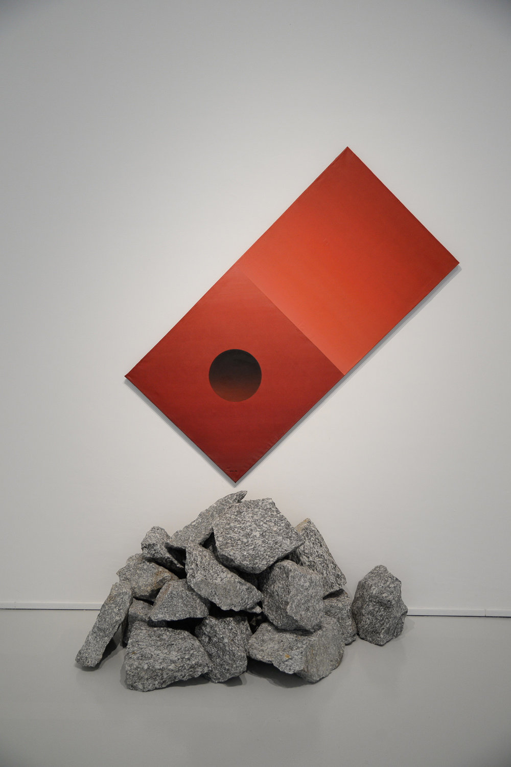 Po Po, 'Red Cube', 1986, oil on canvas, paper collage and gneiss, 218 x 154 x 50 cm. Collection of National Gallery Singapore. © Hla Oo and Po Po; image courtesy of Po Po and Yavuz Gallery.