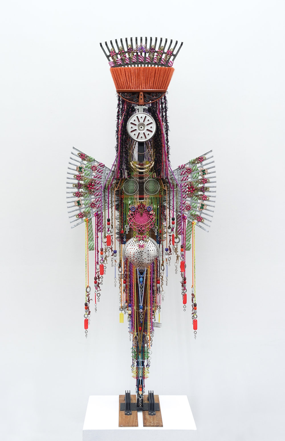 Anne Samat, 'The Goddess of Love', 2017, rattan sticks, yarns, washers, rakes, PVC chains, home, fashion accessories, (kitchen & garden) utensils and stationery items, 304 x 127 x 20cm. Image courtesy of Richard Koh Fine Art and the artist.