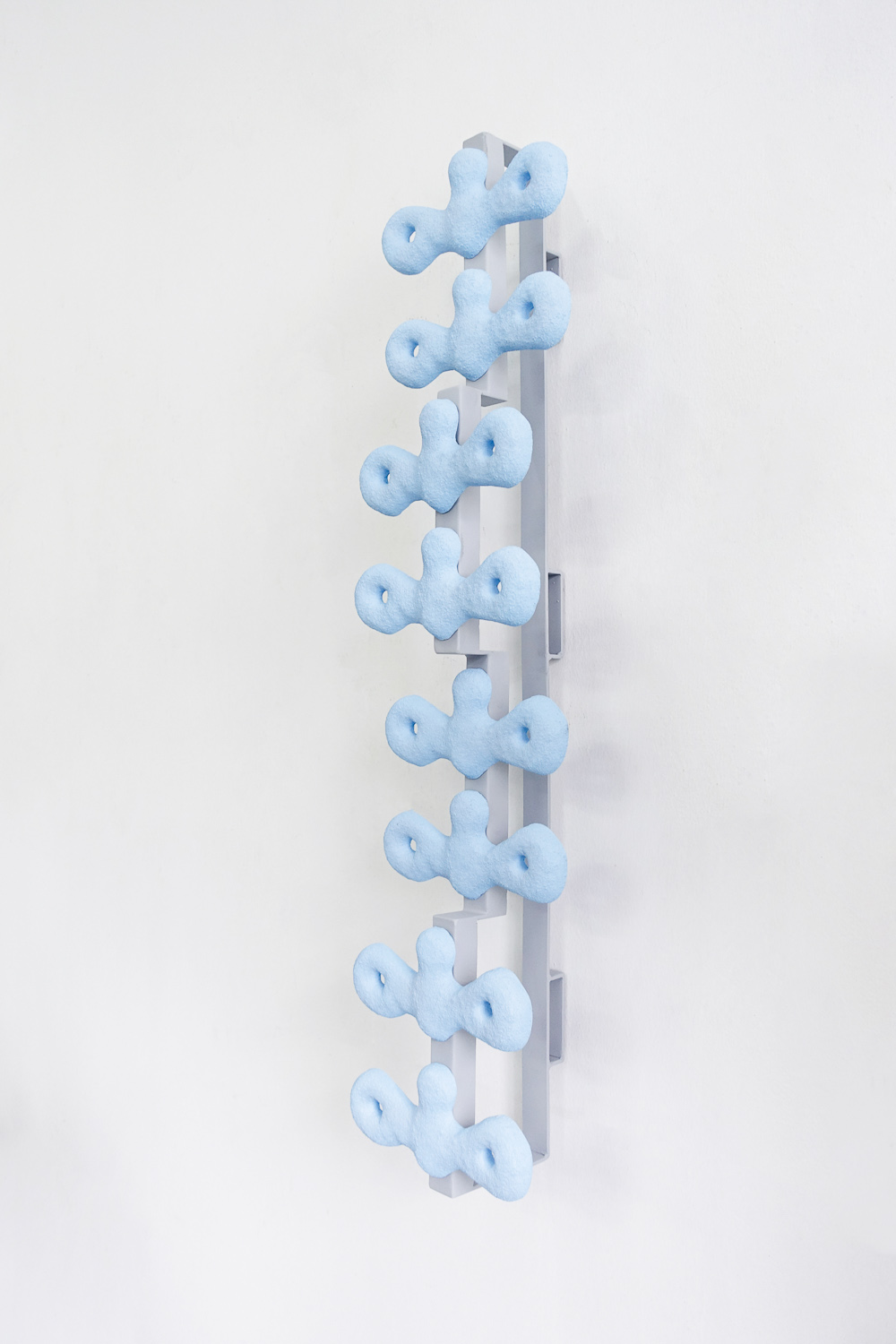Haffendi Anuar, 'Monument to Integrity IV', 2019, jesmonite casts, washers, nuts, bolts and painted steel, 113 x 28 x 28cm. Image courtesy of Richard Koh Fine Art and the artist.