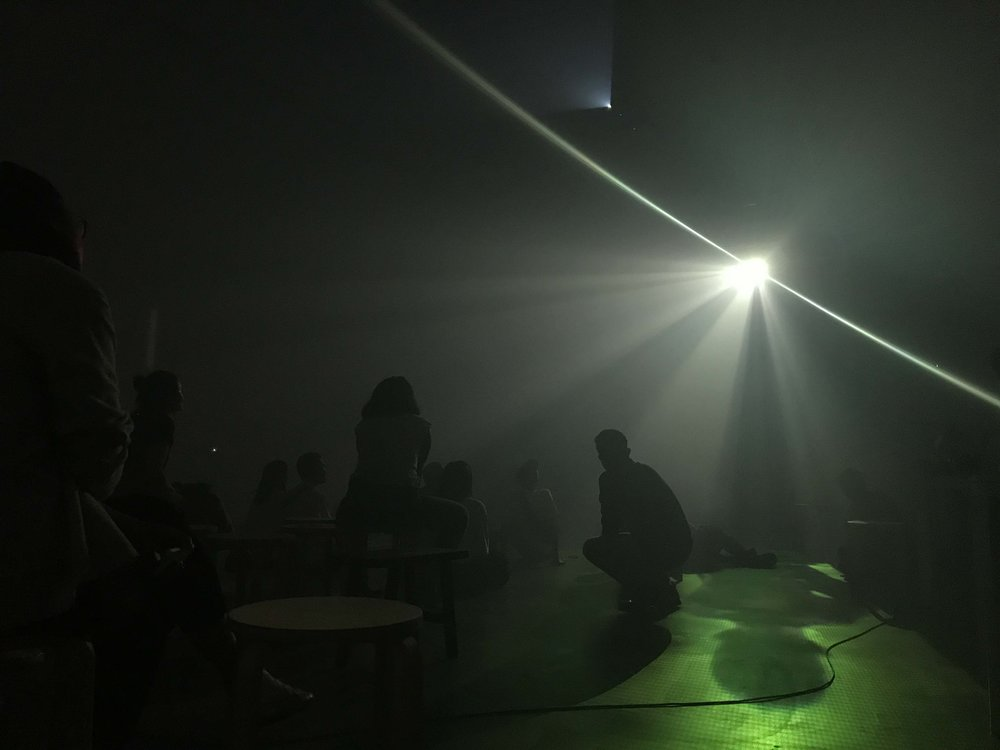 A rehearsal of Apichatpong Weerasethakul's excerpt from 'Fever Room' for 'METAPHORS: AN EVENING OF SOUND AND MOVING IMAGE WITH KICK THE MACHINE' at BangkokCityCity gallery.
