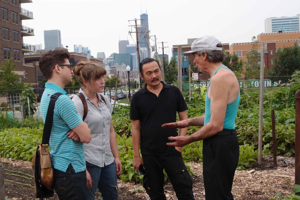 """Kamin Lertchaiprasert and his class vising City Farm in Chicago during the preparation of """"31st Century Museum of Contemporary Spirit Laboratory @ Chicago"""" in 2011. Image courtesy of Vipash Purichanont."""