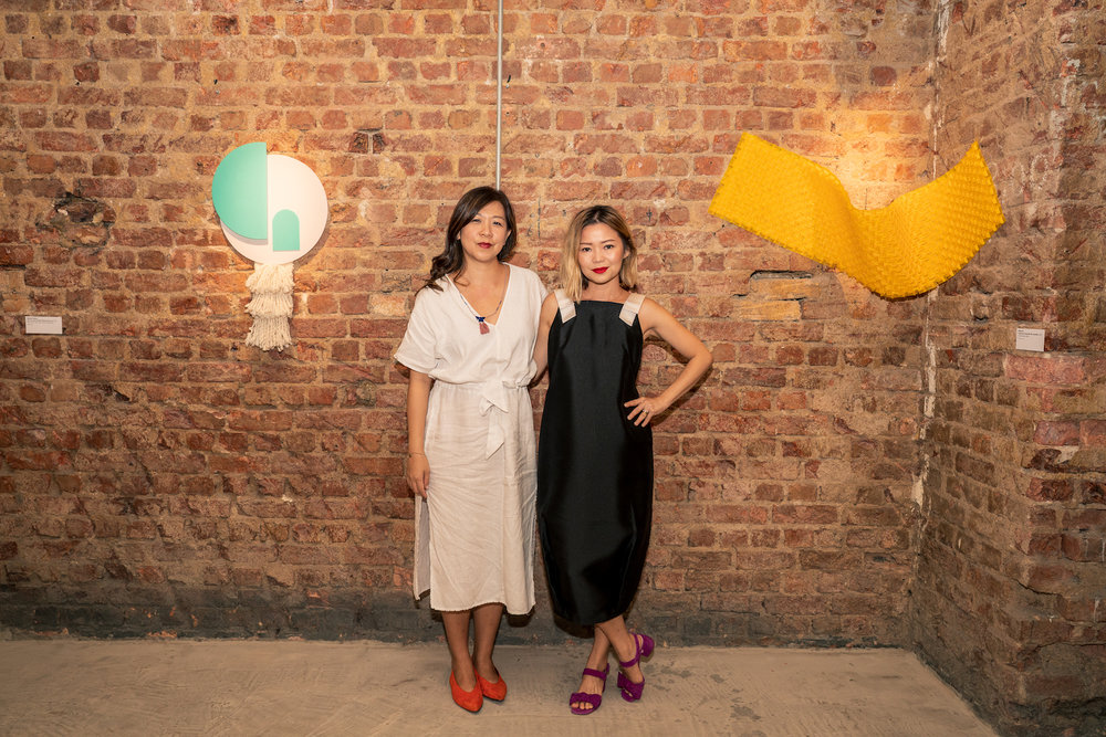 Hazel Lim and Ginette Chittick at the opening of 'Planes and Envelopes'. Image courtesy of UltraSuperNew Gallery, Singapore.