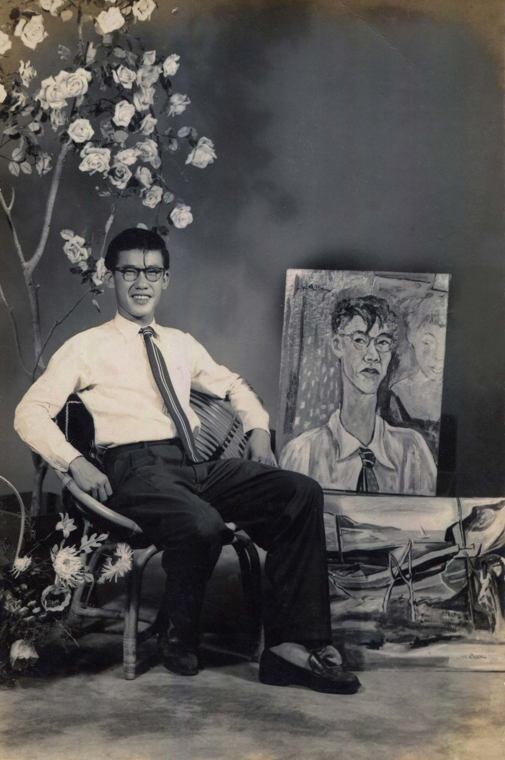 Archival photograph from Chia Yu Chian's family collection showing the artist with his self portrait. Image courtesy of ILHAM Gallery.