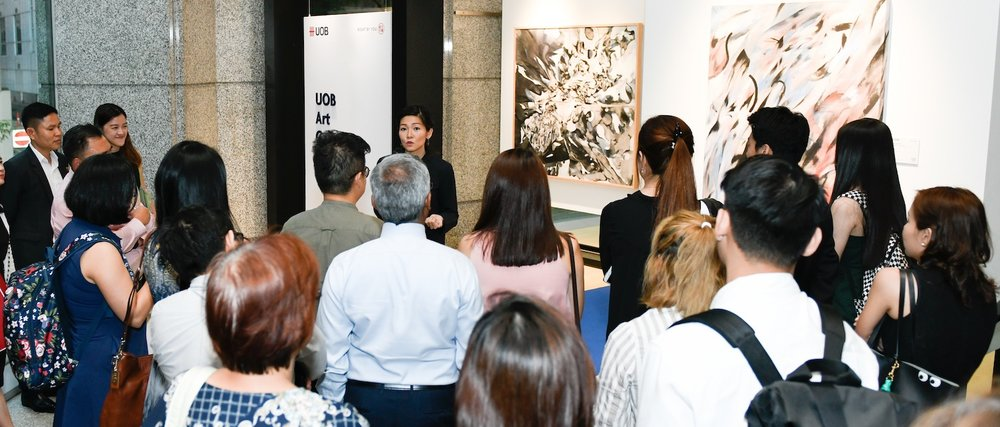 The artist speaking at the opening of 'Enter and Echo'. Image courtesy of UOB Art Gallery.