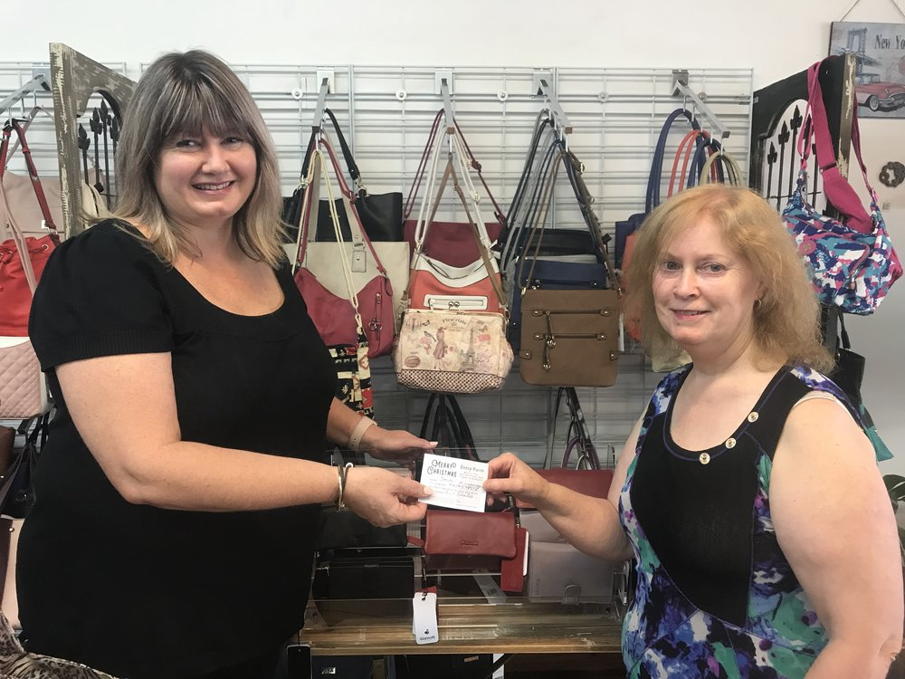 Contraltualtion to our lucky winner - Jaquii Richarson. - Jaquii purchased a purse from Dusty's Bag and Kitchen Shop.