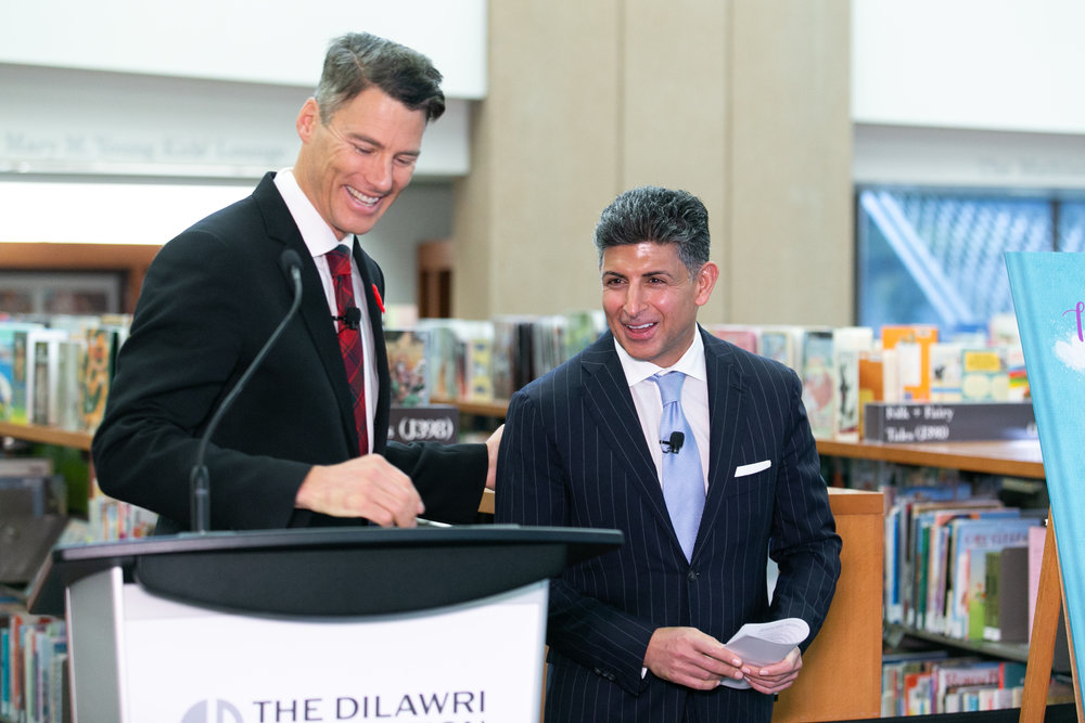 Outgoing Vancouver Mayor Gregor Robertson thanked Ajay Dilawri for his foundation's $5-million donation to Vancouver's Central Branch. (Paul Prefontaine/CBC)