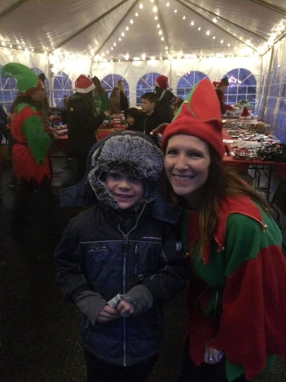 - Max with his elf, who helped him pick out gifts for Steve and I.