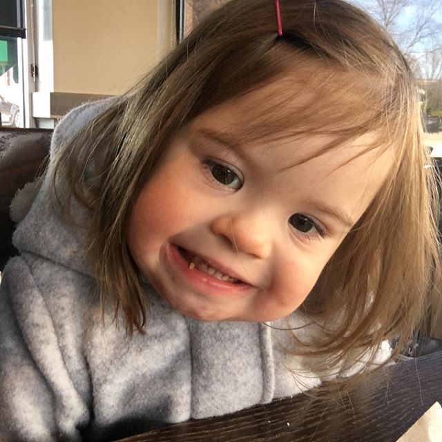 "In our last podcast, we mentioned that Lulu is in the throes of the 3 year old life. Today at @starbucks she didn't get her banana bread fast enough and yelled, ""Eat. Right. NOW!"" Never a dull moment (and then she flashes me this smile as if to say, ""who, me?"" 😇). . . . #downsyndrome #nothingdownaboutit #theluckyfew #trisomy21"