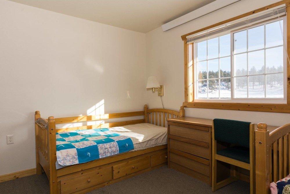 Sleeping room in the barn retreat center.