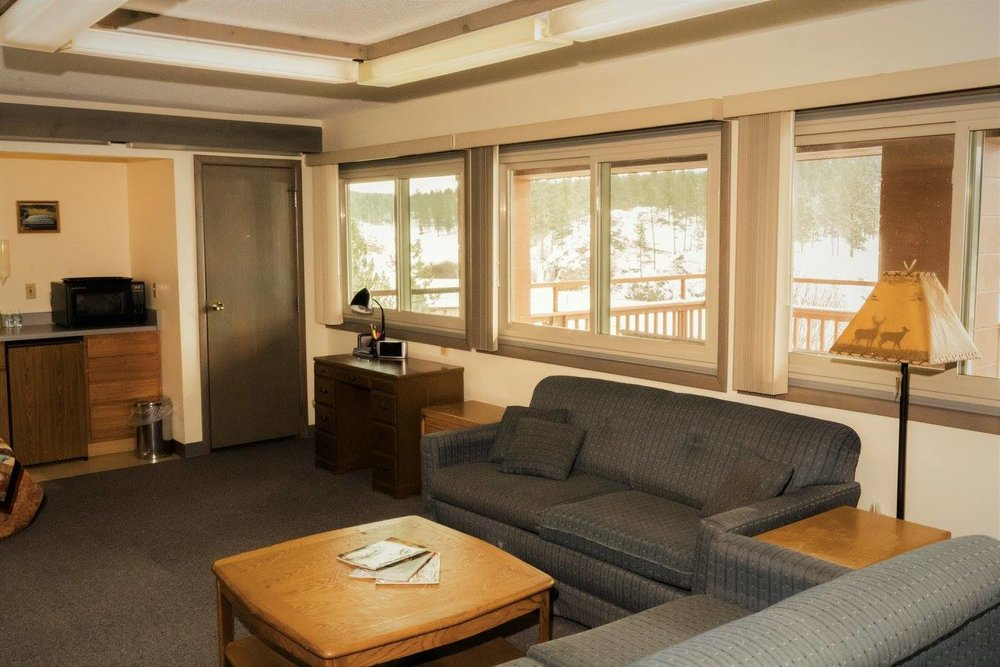The lounge in the lodge retreat center is a perfect place to relax by the fire with a cup of homemade hot cocoa.