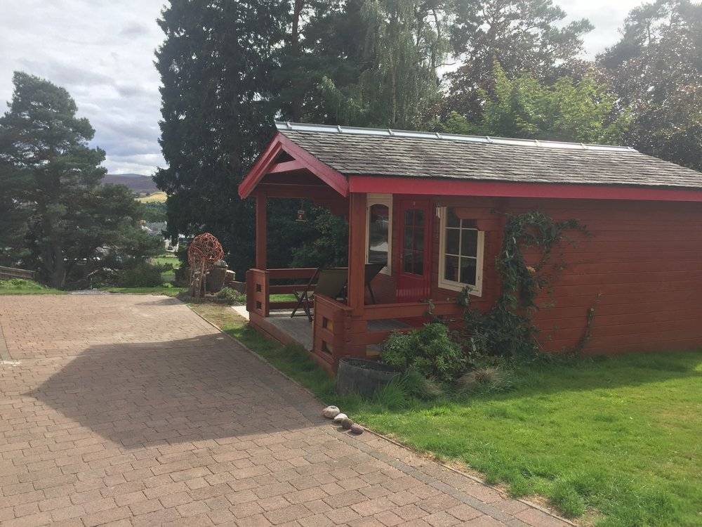 Outdoor space - With a superb outlook onto the mountains you will enjoy the large private garden with its views over to the mountains. The summer house has a games room the perfect escape for kids (and adults!). BBQ available.