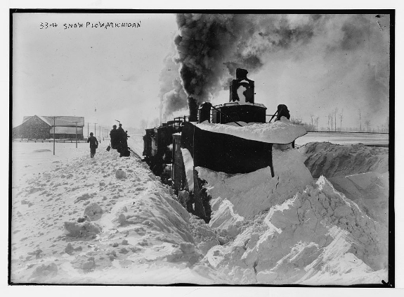 Train plowing snow